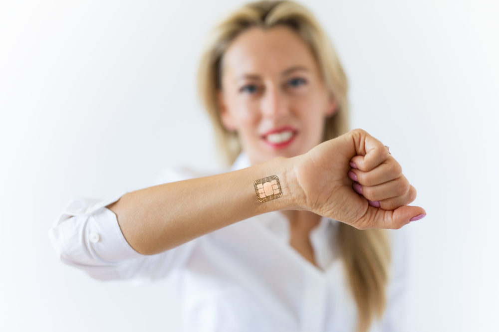 Woman with computer chip implant in hand